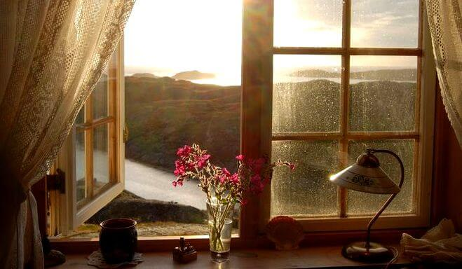 An open window showing a beautiful landscape.