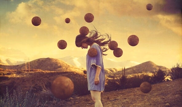 Sad woman surrounded by floating balls.