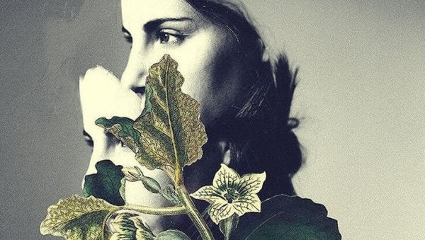 a woman with a plant