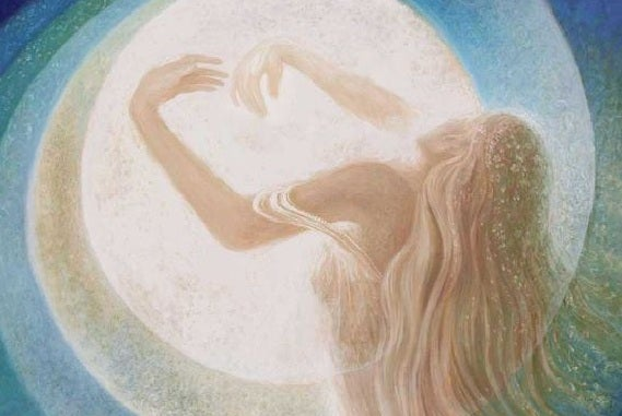 Spirituality: a woman hugging the sun.