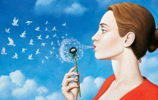 a woman blowing a dandelion, turning into doves