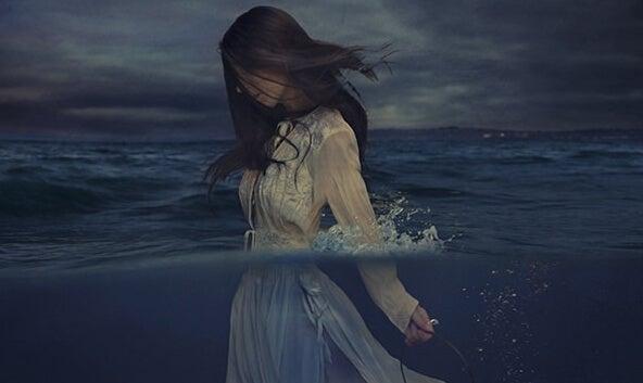 woman walking in the ocean