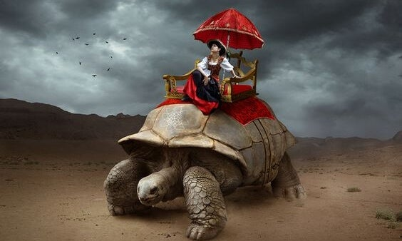 a woman riding in luxury on a giant turtle