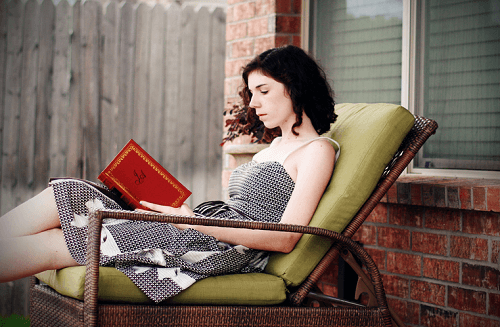 A woman reading outside.