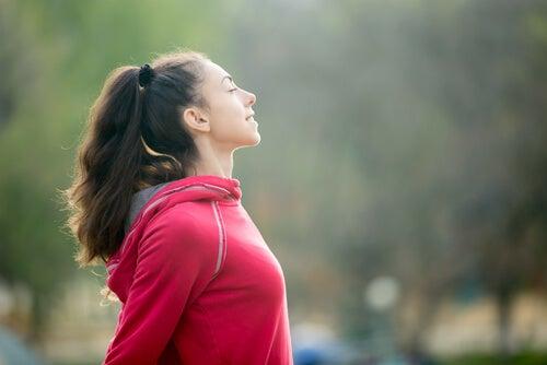a girl exercising outdoors