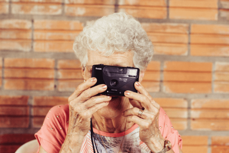 an older woman with dementia taking a picture