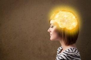 A woman has an illuminated brain.