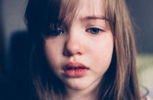 A sad little girl is crying.