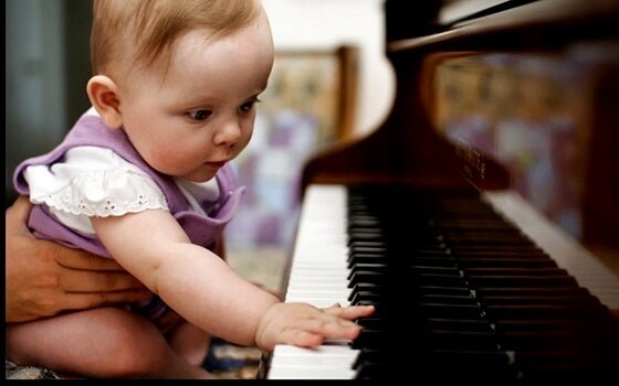 musical intelligence in a baby playing the piano