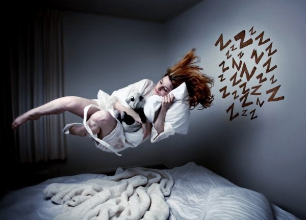 A woman flying over her bed in recurring nightmares.