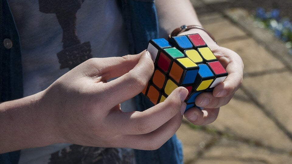 person solving Rubik's cube