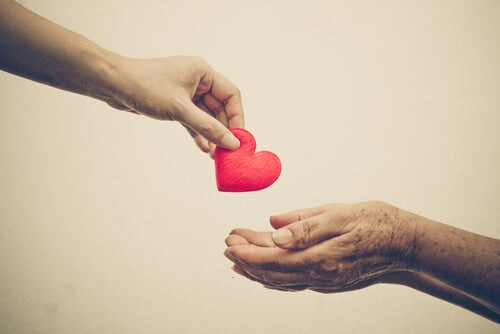 hand giving heart