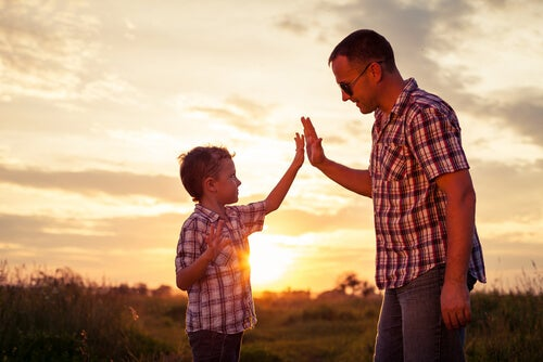 A father and son are in a field.