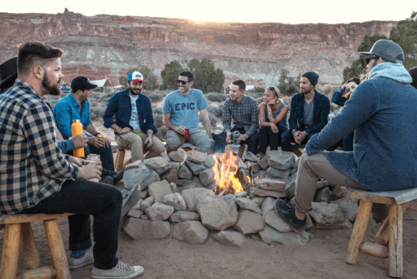 friends enjoying time around a bonfire: effective social skills
