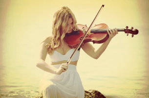 Girl in white playing the violin.