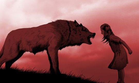 A wolf and a girl roaring at each other.