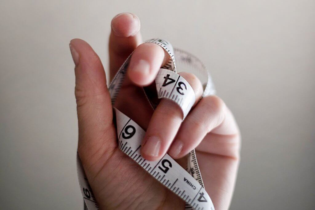 An eating disorder and a measuring tape.