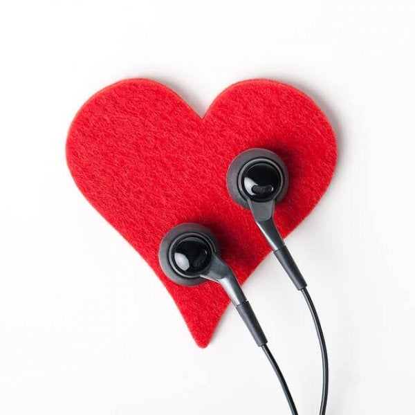Listening to the heart: earbuds on a felt heart.