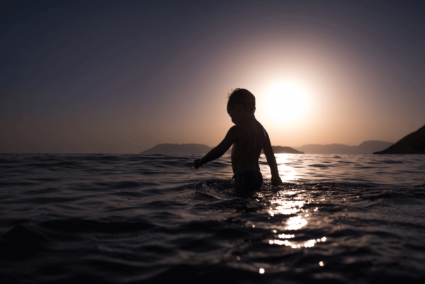 a boy swimming in the sea