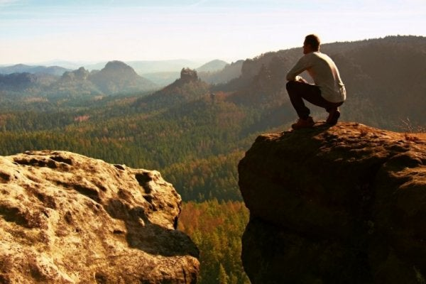 The psychology of willpower as pictured by a man on a cliff.