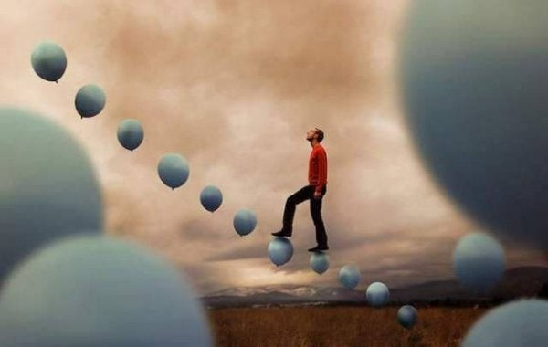 A man walking on balloons.