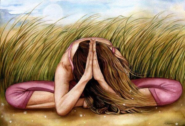 A woman meditating in a field, developing her intuition.