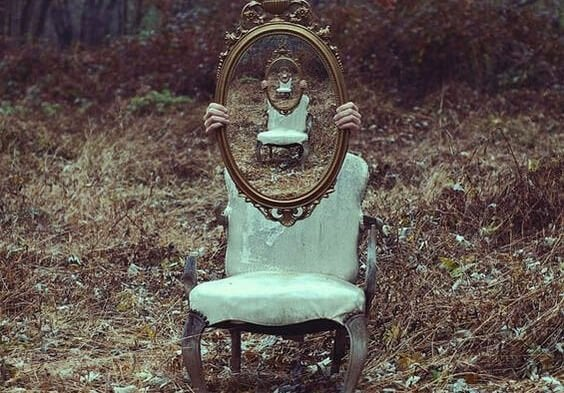 A mirror on a chair.