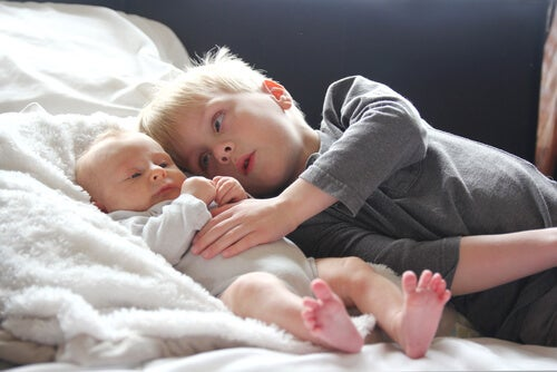 Older siblings: a baby and his older brother.