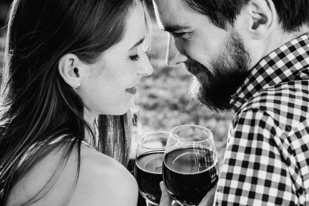A couple with wine: male and female brains.