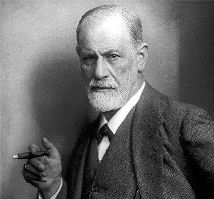 A portrait of Sigmund Freud smoking a cigar.