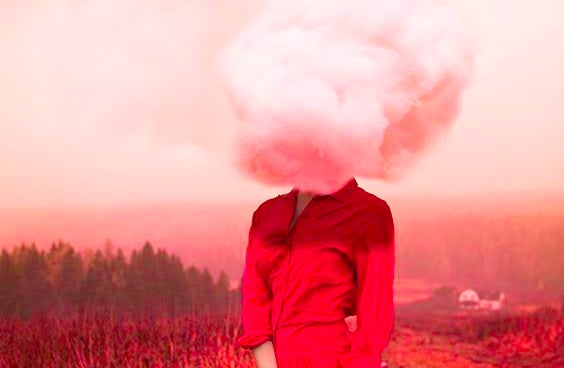 Woman in red with cloud for a head.