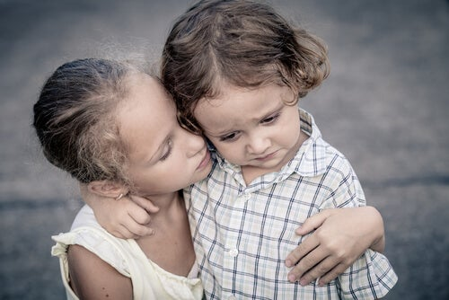 Siblings crying together
