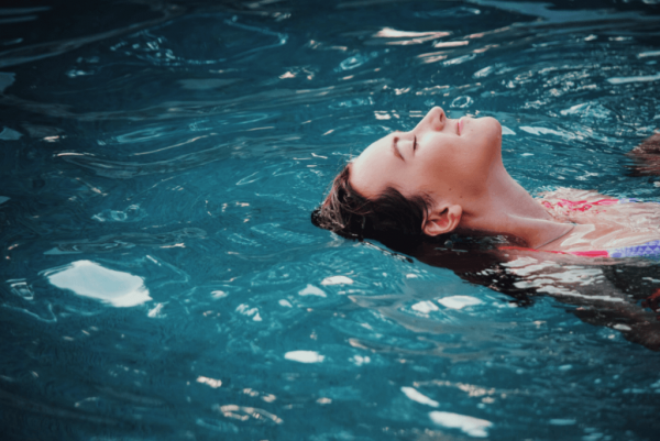 Personality and emotions: a woman floating in the water.