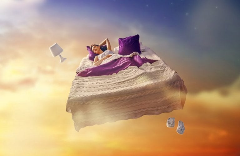 A woman is sleeping in a bed in the clouds.