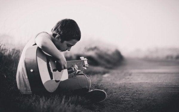 Grief in children, boy playing guitar