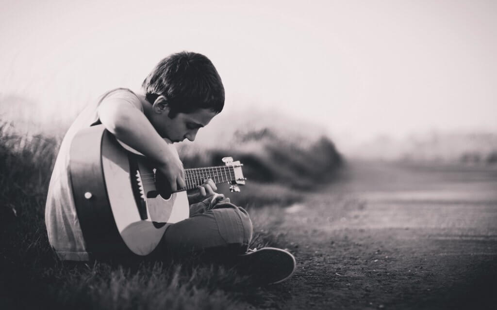 Grief in children, boy playing guitar