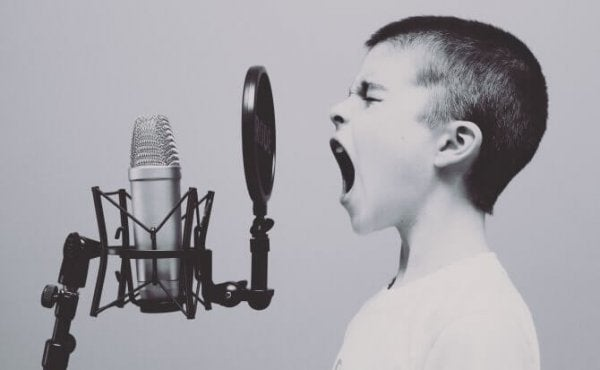 A child yelling into a microphone.