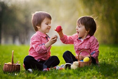 Social skills in children: two kids playing with Easter eggs.