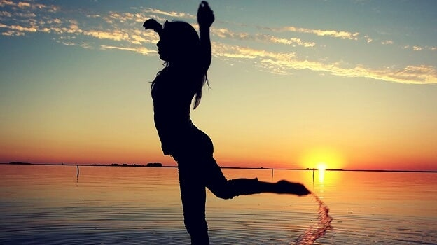 Dancing on the beach at sunset.