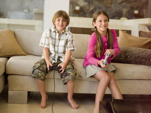 A girl and a boy are playing video games.