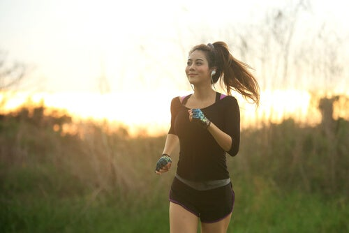 A girl jogging while listening to music.