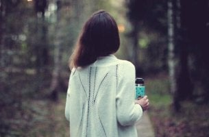 girl walking in woods thinking do I stay