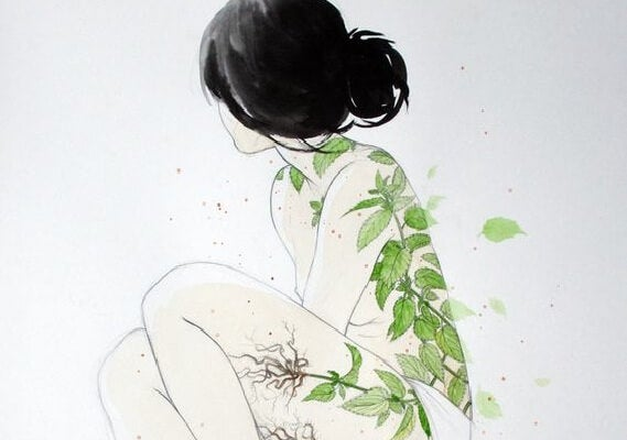 Girl with tree leaves on her skin.