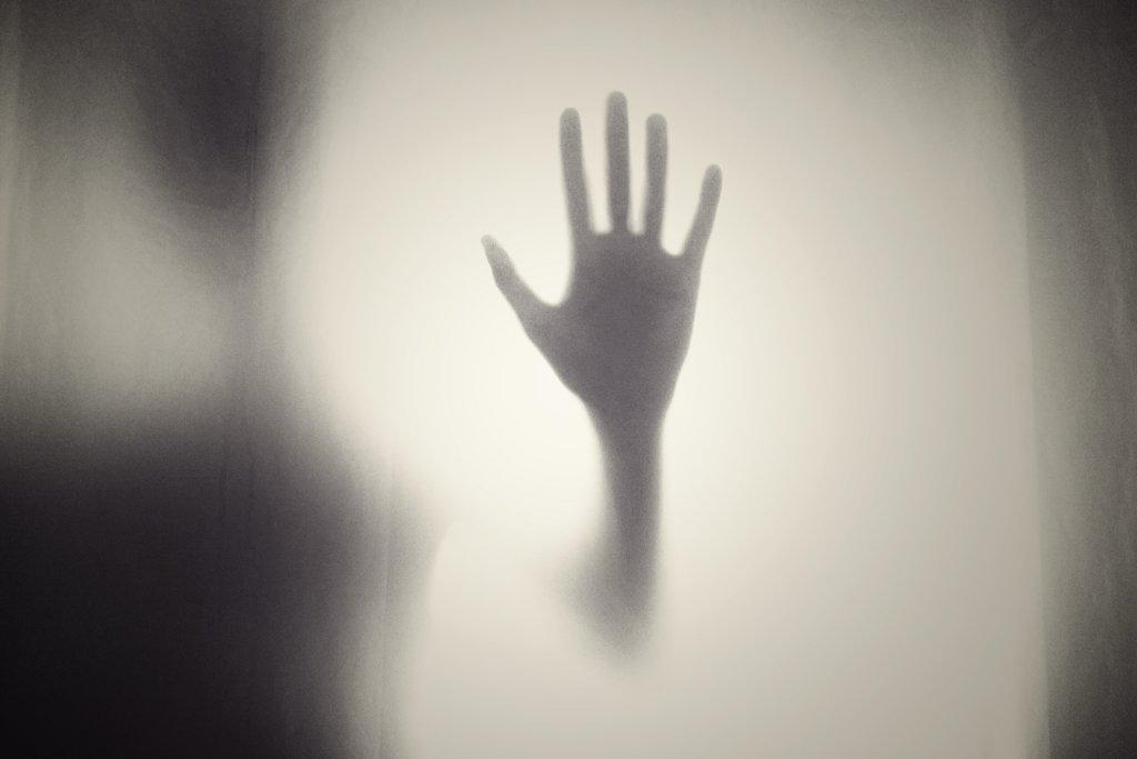 A hand symbolizing domestic abuse.