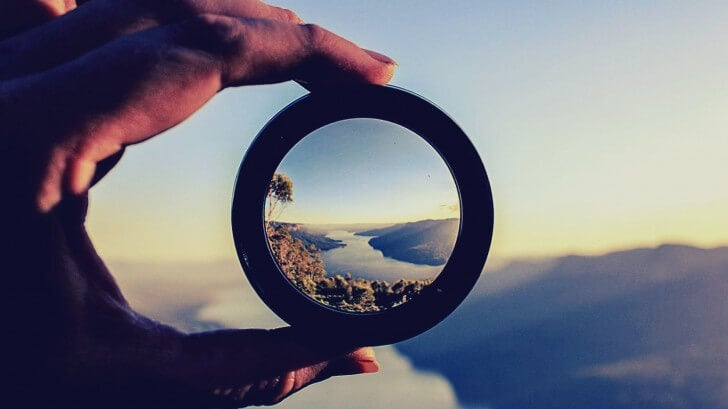 A magnifying glass picturing how to motivate yourself.
