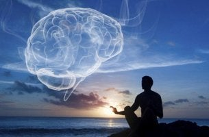 A man is meditating with a figure of a brain in the sky.