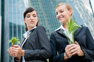 girls holding plants