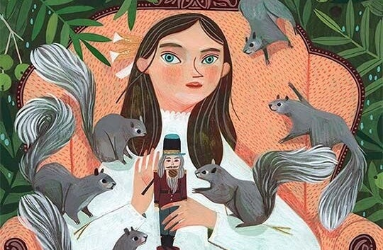 woman with a bunch of squirrels around her