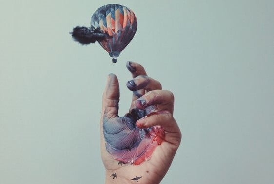 hand and balloon