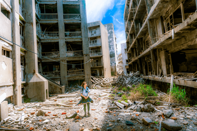 A school girl is walking through ruins.